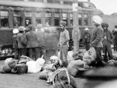 Image 1-First Sikhs in Canada. Sikh labourers board a train in Vancouver